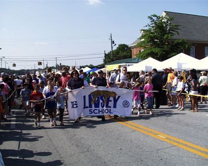 Livsey Elementary School banner and people